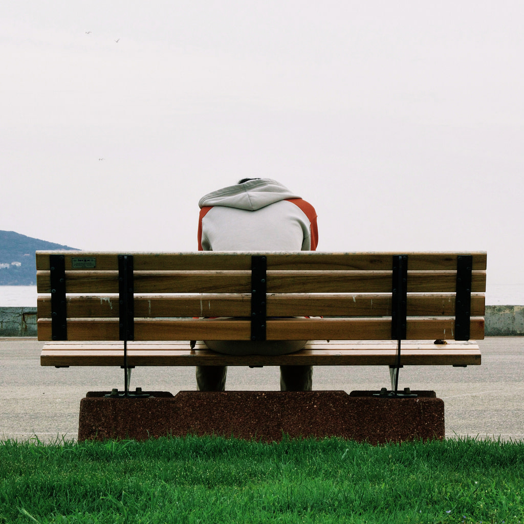 Man on bench depressed