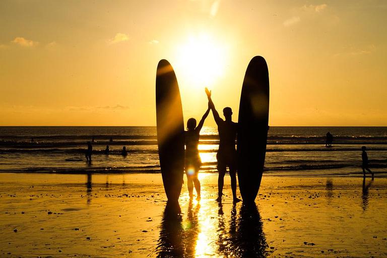 Beach surfers in Bali
